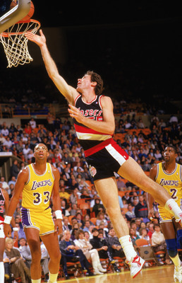 LOS ANGELES - DECEMBER 1987:  Kiki Vandeweghe #55 of the Portland Trail Blazers shoots a layup against Kareem Abdul-Jabbar #33 and Earvin 'Magic' Johnson #32 of the Los Angeles Lakers during a December 1987-1988 NBA season game at the Great Western Forum