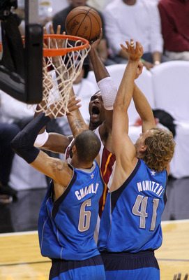 MIAMI, FL - JUNE 12:  Chris Bosh #1 of the Miami Heat attempts a shot against Tyson Chandler #6 and Dirk Nowitzki #41 of the Dallas Mavericks in Game Six of the 2011 NBA Finals at American Airlines Arena on June 12, 2011 in Miami, Florida. NOTE TO USER: U