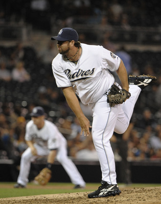 SAN DIEGO, CA - AUGUST 18:  Heath Bell #21 of the San Diego Padres pitches during the ninth inning of a baseball game against the Florida Marlins at Petco Park on August 18, 2011 in San Diego, California.  The Padres won 3-1. (Photo by Denis Poroy/Getty I