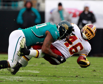 JACKSONVILLE, FL - DECEMBER 26:   Ryan Torain #46 of the Washington Redskins is tackled by Derrick Harvey #91 of the Jacksonville Jaguars during the game at EverBank Field on December 26, 2010 in Jacksonville, Florida.  (Photo by Sam Greenwood/Getty Image