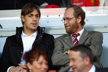 LIVERPOOL, ENGLAND - AUGUST 27:  New Liverpool signing Sebastian Coates (L) looks on ahead of the the Barclays Premier League match between Liverpool and Bolton Wanderers at Anfield on August 27, 2011 in Liverpool, England.  (Photo by Clive Brunskill/Gett