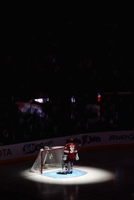 GLENDALE, AZ - APRIL 20:  Goaltender Ilya Bryzgalov #30 of the Phoenix Coyotes stands attended for the National Anthem before Game Four of the Western Conference Quarterfinals against the Detroit Red Wings during the 2011 NHL Stanley Cup Playoffs at Jobin