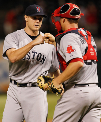 ARLINGTON, TX - AUGUST 24:  Pitcher Jonathan Papelbon #58 of the Boston Red Sox celebrates with Ryan Lavarnway #60 of the Boston Red Sox after the Red Sox beat the Texas Rangers 13-2 at Rangers Ballpark in Arlington on August 24, 2011 in Arlington, Texas.
