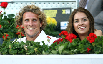 MADRID, SPAIN - MAY 05:  Diego Forlan of Athletico Madrid with girlfriend Zaira Nara watch on during day six of the Mutua Madrilena Madrid Open Tennis on May 5, 2011 in Madrid, Spain.  (Photo by Julian Finney/Getty Images)