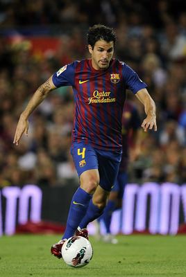 BARCELONA, SPAIN - AUGUST 22:  Cesc Fabregas of FC Barcelona runs with the ball during the Joan Gamper Trophy match between FC Barcelona and SSC Napoli at the Camp Nou Stadium on August 22, 2011 in Barcelona, Spain.  (Photo by David Ramos/Getty Images)