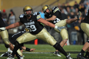 BOULDER, CO - NOVEMBER 20:  Place kicker Aric Goodman #13 of the Colorado Buffaloes kicks a field goal against the Kansas State Wildcats at Folsom Field on November 20, 2010 in Boulder, Colorado.  (Photo by Doug Pensinger/Getty Images)