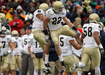EL PASO, TX - DECEMBER 30:  Safety Harrison Smith #22 celebrates a pass interception with Robert Blanton #12 of the Notre Dame Fighting Irish during play against the Miami Hurricanes at Sun Bowl on December 30, 2010 in El Paso, Texas.  (Photo by Ronald Ma