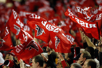 ATLANTA, GA - JANUARY 15:  Fans of the Atlanta Falcons wave flags which read 'Rise Up' against the Green Bay Packers during their 2011 NFC divisional playoff game at Georgia Dome on January 15, 2011 in Atlanta, Georgia.  (Photo by Chris Graythen/Getty Ima