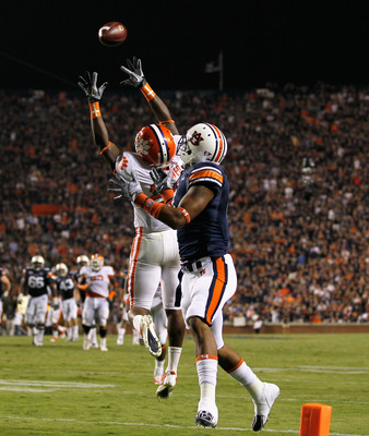 AUBURN, AL - SEPTEMBER 18:  Xavier Brewer #29 of the Clemson Tigers intercepts a pass intended for Shaun Kitchens #4 of the Auburn Tigers at Jordan-Hare Stadium on September 18, 2010 in Auburn, Alabama.  (Photo by Kevin C. Cox/Getty Images)