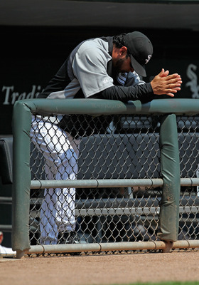 CHICAGO, IL - AUGUST 31: Manager Ozzie Guillen #13 of the Chicago White Sox reacts after pitcher Jake Peavy gives up a home run ball against the Minnesota Twins in the 1st inning at U.S. Cellular Field on August 31, 2011 in Chicago, Illinois. (Photo by Jo