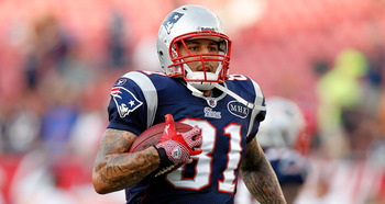 TAMPA, FL - AUGUST 18:  Tightend Aaron Hernandez #81 of the New England Patriots warms up just prior to the start of the preseason game against the Tampa Bay Buccaneers at Raymond James Stadium on August 18, 2011 in Tampa, Florida.  (Photo by J. Meric/Get