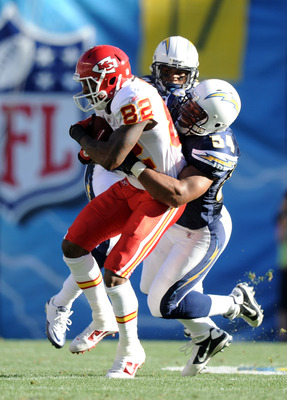 SAN DIEGO, CA - DECEMBER 12:  Dexter McCluster #22 of the Kansas City Chiefs is tackled after a catch by Stephen Cooper #54 and Dante Hughes #33 of the San Diego Chargers during the first quarter at Qualcomm Stadium on December 12, 2010 in San Diego, Cali