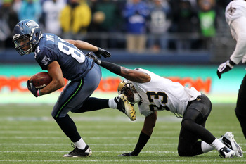 SEATTLE, WA - JANUARY 08:  Golden Tate #81 of the Seattle Seahawks runs down field against Jabari Greer #33 of the New Orleans Saints during the 2011 NFC wild-card playoff game at Qwest Field on January 8, 2011 in Seattle, Washington.  (Photo by Jonathan 
