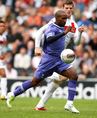 MILTON KEYNES, ENGLAND - JULY 26: Jermain Defoe of Tottenham Hotspur and Gary McKenzie of MK Dons battle for the ball during the Pre Season Friendly match between Mk Dons and Tottenham Hotspur at Stadium MK on July 26, 2011 in Milton Keynes, England. (Pho