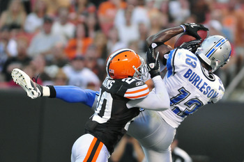CLEVELAND, OH - AUGUST 19: Nate Burleson #13 of the Detroit Lions catches a touchdown pass over Mike Adams #20 of the Cleveland Browns during the first quarter at Cleveland Browns Stadium on August 19, 2011 in Cleveland, Ohio. (Photo by Jason Miller/Getty