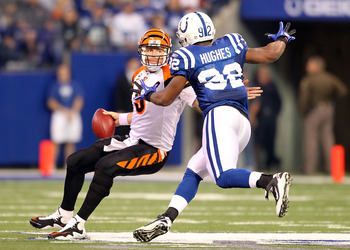 INDIANAPOLIS - NOVEMBER 14:  Carson Palmer #9 of the Cincinnati Bengals tries to avoid Jerry Hughes #92 of the Indianapolis Colts during the NFL game at Lucas Oil Stadium on November 14, 2010 in Indianapolis, Indiana. The Colts won 23-17.  (Photo by Andy 
