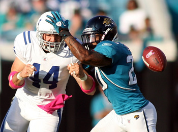 JACKSONVILLE, FL - OCTOBER 03:  Tight end Dallas Clark #44 of the Indianapolis Colts cannot hold onto a pass as he is defended by Anthony Smith #20 of the Jacksonville Jaguars at EverBank Field on October 3, 2010 in Jacksonville, Florida.  (Photo by Marc