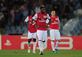 UDINE, ITALY - AUGUST 24:  Alex Song of Arsenal looks on during the UEFA Champions League play-off second leg match between Udinese Calcio and Arsenal FC at the Stadio Friuli on August 24, 2011 in Udine, Italy.  (Photo by Jamie McDonald/Getty Images)