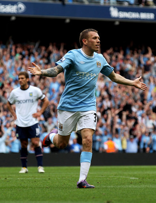 MANCHESTER, ENGLAND - MAY 01:  Craig Bellamy of Manchester City celebrates after scoring his team's third goal during the Barclays Premier League match between Manchester City and Aston Villa at the City of Manchester Stadium on May 1, 2010 in Manchester,