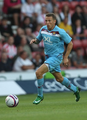 SOUTHAMPTON, UNITED KINGDOM - AUGUST 01:  Craig Bellamy of West Ham running with the ball during the Pre Season Friendly match between Southampton and West Ham United at St Mary's Stadium on August 1, 2008 in Southampton, England.  (Photo by Hamish Blair/