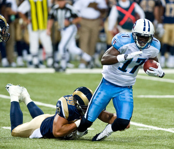 ST.LOUIS, MO - AUGUST 20: Damian Williams #17 of the Tennessee Titans is tackled by C.J. Ah You #99 of the St. Louis Rams during a pre-season game at the Edward Jones Dome on August 20, 2011 in St.Louis, Missouri.  (Photo by Ed Szczepanski/Getty Images)2