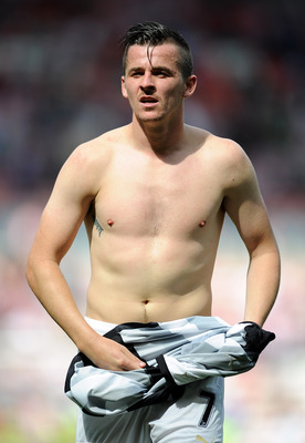 SUNDERLAND, ENGLAND - AUGUST 20:  Joey Barton of Newcastle United takes his shirt off at full-time following the Barclays Premier League match between Sunderland and Newcastle United at Stadium of Light on August 20, 2011 in Sunderland, England.  (Photo b