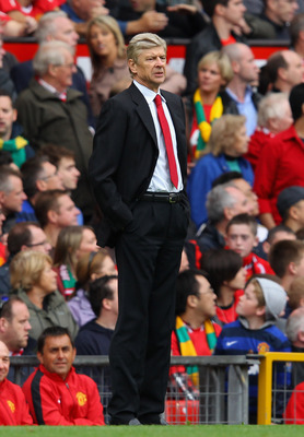 MANCHESTER, ENGLAND - AUGUST 28:  Arsenal manager Arsene Wenger looks on during the Barclays Premier League match between Manchester United and Arsenal at Old Trafford on August 28, 2011 in Manchester, England.  (Photo by Alex Livesey/Getty Images)