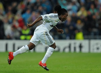 MADRID, SPAIN - OCTOBER 21:  Royston Drenthe of Real Madrid celebrates scoring his side equalizing goal during the Champions League group C match between Real Madrid and AC Milan at the Estadio Santiago Bernabeu on October 21, 2009 in Madrid, Spain. AC Mi