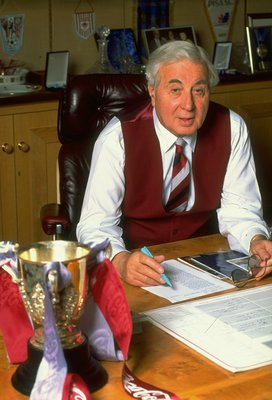 Mar 1994:  Aston Villa Chairman Doug Ellis at work in his office with the Coca Cola Cup trophy on his desk. \ Mandatory Credit: Stu Forster /Allsport