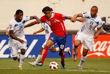 EAST RUTHERFORD, NJ - JUNE 18:  Bryan Ruiz #10 of Costa Rica battles for possession against Victor Bernardez #5 and Juan Carlos Garcia #21 of Honduras during the 2011 Gold Cup Quarterfinals on June 18, 2011 at the New Meadowlands Stadium in East Rutherfor