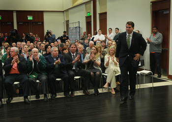CORAL GABLES, FL - DECEMBER 13:  Former Temple University football coach Al Golden, 41, walks to the podium as he is introduced as the new head coach at the University of Miami  on December 13, 2010 in Coral Gables, Florida.  Golden is replacing Randy Sha