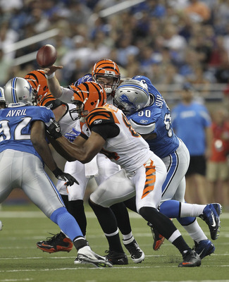 DETROIT - AUGUST 12: Ndamukong Suh #90 of the Detroit Lions hits quarterback Andy Dalton #14 of the Cincinnati Bengals in the second quarter and is called for a roughing the passer penalty during the game at Ford Field on August 12, 2011 in Detroit, Michi