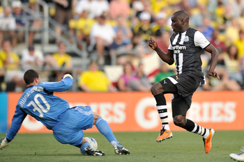 COLUMBUS, OH - JULY 26:  Goalkeeper Andy Gruenebaum #30 of the Columbus Crew comes out of the box to defend against an attack from Demba Ba #19 of Newcastle United FC in the first half on July 26, 2011 at Crew Stadium in Columbus, Ohio. Gruenebaum was ass