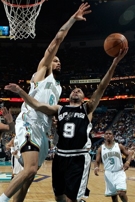 NEW ORLEANS - MAY 05:  Tony Parker #9 of the San Antonio Spurs has a shot blocked by Tyson Chandler #6 of the New Orleans Hornets in Game Two of the Western Conference Semifinals during the 2008 NBA Playoffs at The New Orleans Arena May 5, 2008 in New Orl