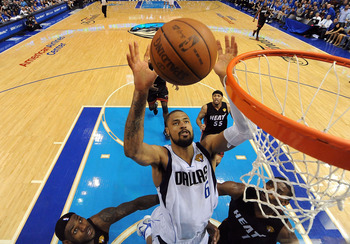 DALLAS, TX - JUNE 09:  Tyson Chandler #6 of the Dallas Mavericks reaches for a rebound against LeBron James #6 and Chris Bosh #1 of the Miami Heat in Game Five of the 2011 NBA Finals at American Airlines Center on June 9, 2011 in Dallas, Texas.  NOTE TO U