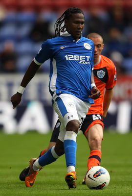 WIGAN, ENGLAND - AUGUST 27:  Hugo Rodallega of Wigan Athletic beats Michael Harriman of Queens Park Rangers during the Barclays Premier League match between Wigan Athletic and Queens Park Rangers at the DW Stadium on August 27, 2011 in Wigan, England.  (P