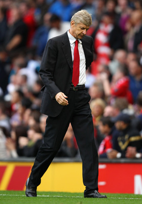 MANCHESTER, ENGLAND - AUGUST 28:  Arsenal manager Arsene Wenger looks dejected as he walks off at half time during the Barclays Premier League match between Manchester United and Arsenal at Old Trafford on August 28, 2011 in Manchester, England.  (Photo b