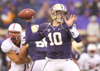 SEATTLE - OCTOBER 30:  Quarterback Jake Locker #10 of the Washington Huskies passes against the Stanford Cardinal on October 30, 2010 at Husky Stadium in Seattle, Washington. (Photo by Otto Greule Jr/Getty Images)