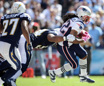 SAN DIEGO - OCTOBER 24:  BenJarvus Green-Ellis #42 of the New England Patriots is tackled by Stephen Cooper #54 and chased by Paul Oliver #27  of theSan Diego Chargers at Qualcomm Stadium on October 24, 2010 in San Diego, California.  (Photo by Harry How/