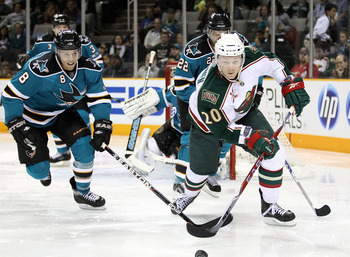 SAN JOSE, CA - JANUARY 22:  Antti Miettinen #20 of the Minnesota Wild and Joe Pavelski #8 of the San Jose Sharks at HP Pavilion on January 22, 2011 in San Jose, California.  (Photo by Ezra Shaw/Getty Images)
