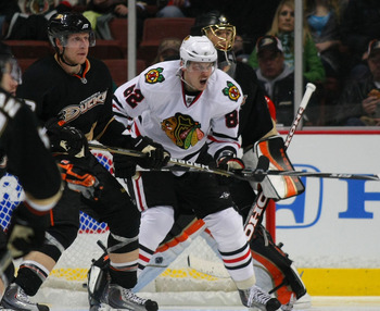 ANAHEIM, CA - JANUARY 02:  Tomas Kopecky #82 of the Chicago Blackhawks positions himself in the Ducks' crease area as Toni Lydman #32 of the Anaheim Ducks defends the play during the NHL game at Honda Center on January 2, 2011 in Anaheim, California. The
