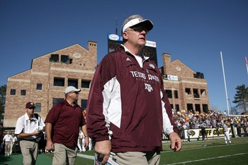 BOULDER, CO - NOVEMBER 07:  Head coach Mike Sherman of the Texas A&amp;M Aggies enters the field for the second half as he leads his team against the Colorado Buffaloes during NCAA college football action at Folsom Field on November 7, 2009 in Boulder, Colora