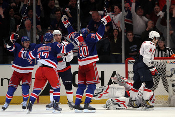 NEW YORK, NY - APRIL 17: Brandon Dubinsky #17 and Vaclav Prospal #20 of the New York Rangers celebrate after Prospal scored a third period goal as Alex Ovechkin #8 of the Washington Capitals skates away from the celebration in Game Three of the Eastern Co