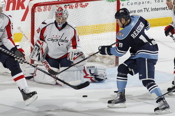 SUNRISE, FL - APRIL 9: Goaltender Michal Neuvirth #30 of the Washington Capitals stops a shot by Marty Reasoner #19 of the Florida Panthers during the third period on April 9, 2011 at the BankAtlantic Center in Sunrise, Florida. The Panthers defeated the