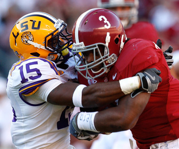 TUSCALOOSA, AL - NOVEMBER 07:  Trent Richardson #3 of the Alabama Crimson Tide rushes upfield against Brandon Taylor #15 of the Louisiana State University Tigers at Bryant-Denny Stadium on November 7, 2009 in Tuscaloosa, Alabama.  (Photo by Kevin C. Cox/G