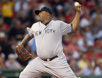 BOSTON, MA - AUGUST 30:  CC Sabathia #52 of the New York Yankees delivers a pitch in the first inning against the Boston Red Sox on August 30, 2011 at Fenway Park in Boston, Massachusetts.  (Photo by Elsa/Getty Images)