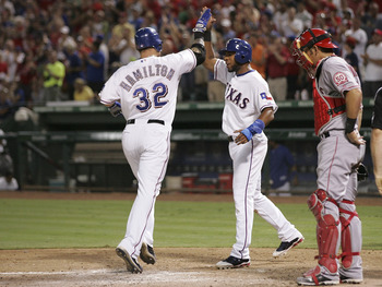 ARLINGTON, TX - AUGUST 28: Josh Hamilton #32 of the Texas Rangers is congratulated by Elvis Andrus #1 for his home hit in the third inning to tie the game against the Los Angeles Angels of Anaheim  at Rangers Ballpark in Arlington on August 28, 2011 in Ar