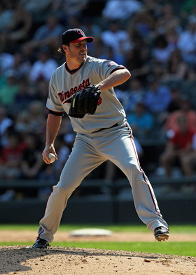 CHICAGO, IL - AUGUST 31:  Joe Nathan #36 of the Minnesota Twins pitches in the 9th inning against the Chicago White Sox at U.S. Cellular Field on August 31, 2011 in Chicago, Illinois. The Twins defeated the White Sox 7-6.  (Photo by Jonathan Daniel/Getty