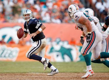MIAMI - SEPTEMBER 16: Quarterback Tony Romo #9 of the Dallas Cowboys scrambles against the Miami Dolphins' defense at Dolphin Stadium on September 16, 2007 in Miami, Florida. The Cowboys defeated the Dolphins 37-20.  (Photo by Allen Kee/Getty Images)