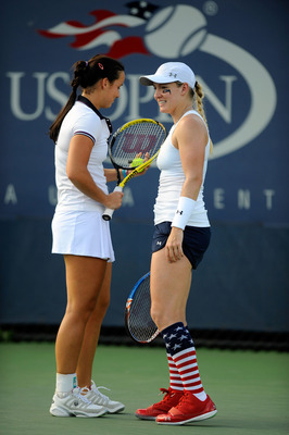 NEW YORK, NY - AUGUST 31:  Jarmila Gajdosova of Australia (L) talks with Bethanie Mattek-Sands of the United States during their doubles match against Jelena Dokic of Australia and Virginie Razzano of France during Day Three of the 2011 US Open at the UST